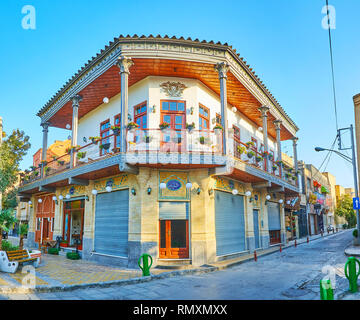 ISFAHAN, IRAN - OCTOBER 21, 2017: The The scenic Armenian manison with corner facade, open terrace, tile decorations, stores on the ground floor and f - Stock Photo