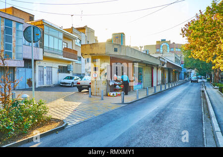 ISFAHAN, IRAN - OCTOBER 21, 2017: The shady street in New Julfa neighborhood with line of the market stores, on October 21 in Isfahan. - Stock Photo