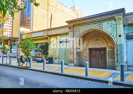 ISFAHAN, IRAN - OCTOBER 21, 2017: Historical Armenian Othodox church gate, decorated with carvings and tile patterns, located in New Julfa neighborhoo - Stock Photo
