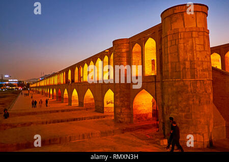 ISFAHAN, IRAN - OCTOBER 21, 2017: Siosepol bridge is perfect place to watch from the Zayandeh river's bank or to walk along it during hot season, when - Stock Photo
