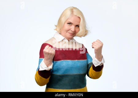 Beautiful blonde adult feeling strong ready to defend herself - Stock Photo