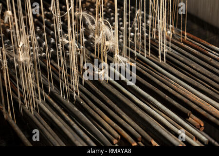Cambodia, Phnom Penh, Koh Dach, Silk Island traditional weaving centre, complex weaving loom heddles, mechanism to separate weft to create complicated - Stock Photo