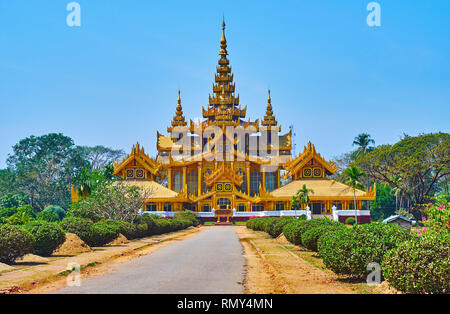 The lush tropic garden emphasizes beauty of Burmese architecture of historic Kanbawzathadi palace, Bago, Myanmar. - Stock Photo
