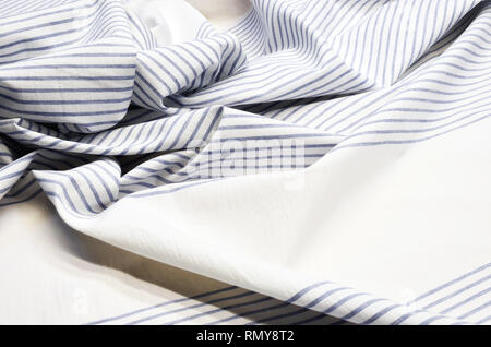 Cotton fabric in blue and white stripes - Stock Photo