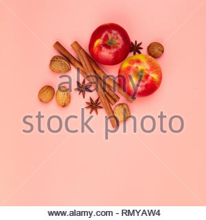 Apples and spices on pink background, flat lay - Stock Photo