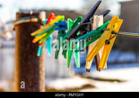 Colorful clothes pins isolated on a line in spring - Stock Photo