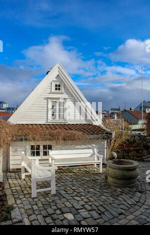 White house and bench in the old town of Stavanger, Norway / Gamle Stavanger - Stock Photo