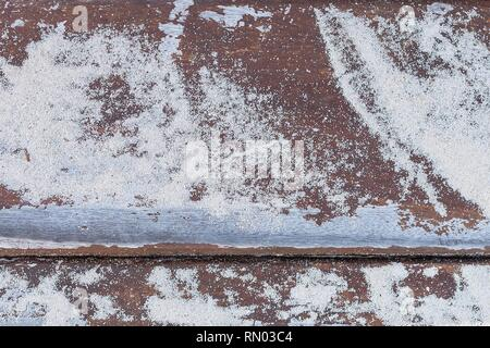Empty natural wooden table background showing rustic sea swept wooden planks on a tropical caribbean beach walk way with sand dusted over them. - Stock Photo