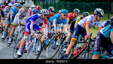 Tour de France 2018 - stage 8. The peloton passing through Marseille en Beauvaisis, France about 60 kilometres from the finish in Amiens - Stock Photo