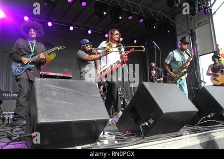 Fishbone is shown performing on stage during a 'live' concert appearance. - Stock Photo