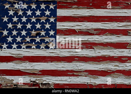 American flag with only 39 stars painted on a wood board outside a house in Alpine, Texas. - Stock Photo