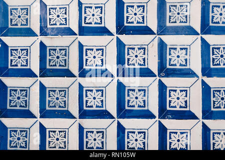 Typical portuguese blue geometrical tiles on the wall - Stock Photo
