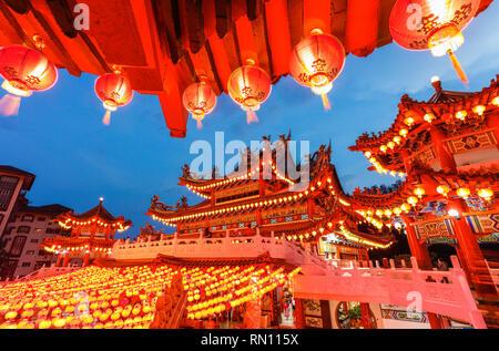 Lanterns glow during the Chinese New Year, Kuala Lumpur, Malaysia. - Stock Photo