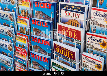 Valley of Noto Sicily. Tourist guides of Noto in different languages - Stock Photo