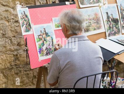 Artist in Rocca della Guaita, the most ancient fortress of San Marino, Italy - Stock Photo