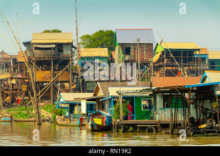 Wooden houses on stilts are home to many families in  floating village on Tonle Sap River, Kampong Chhnang, Mekong Delta, Cambodia, Asia - Stock Photo