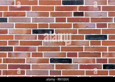 Background from a red and black brick wall - Stock Photo