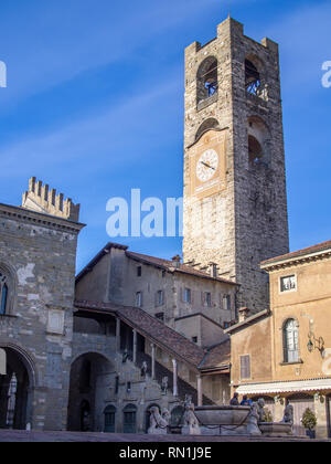 """Piazza Vecchia in Bergamo, Italy with the Torre Civica bell tower also called """"Campanone"""" - Stock Photo"""