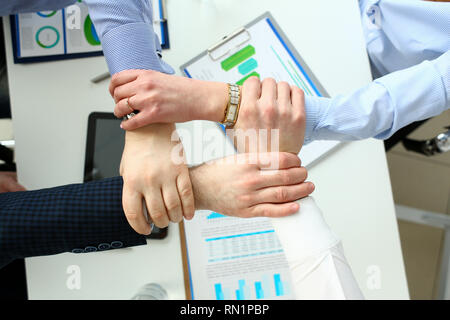 Group business people hold arm in lock - Stock Photo