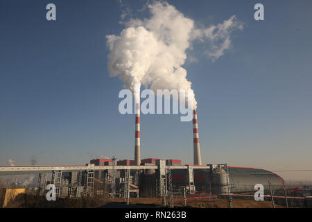 Datong, Shanxi, China. 12th Dec, 2018. Smoke billows from a coal-powered electric power plant and industrial facility in Datong, Shanxi Province (China's coal country), on December 12, 2018. China is the largest producer and consumer of coal in the world, making it the leading emitter of greenhouse gases from coal. China burns much more coal than reported, which has continued to complicate climate talks. Credit: Stephen Shaver/ZUMA Wire/Alamy Live News - Stock Photo
