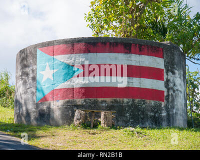 An abstract background image of the flag of Puerto Rico painted on to a concrete tank. - Stock Photo
