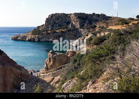 Karpathos island, rocky coast with small beaches of Amopi bay - Aegean sea, Dodecanese Islands, Greece - Stock Photo