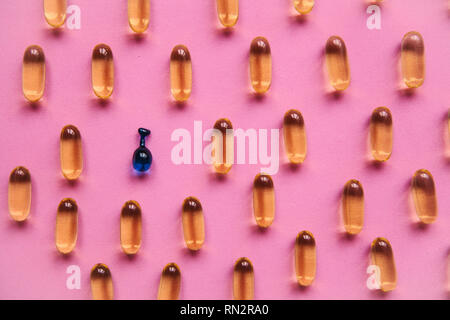 Capsule background with Omega 3, hyaluronic acid. Caring for the health of the skin and body. - Stock Photo