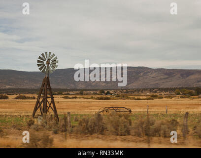 Vintage windmill along California Highway - Stock Photo