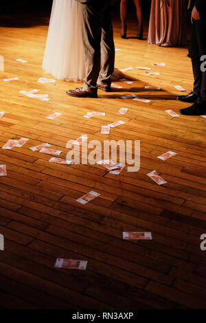 wedding party money scattered on the floor - Stock Photo