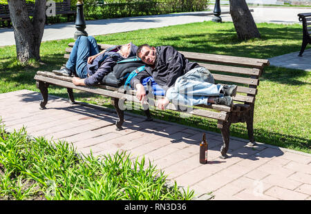Drunk Homeless People Sleeping Outdoors At Night In Tel