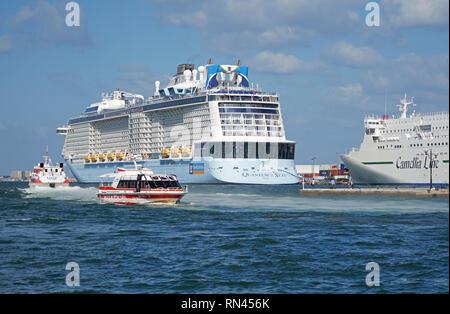 Royal Caribbean mega cruise ship Quantum of the Seas and Camellia Lines ship in port of Fukuoka, Japan. - Stock Photo