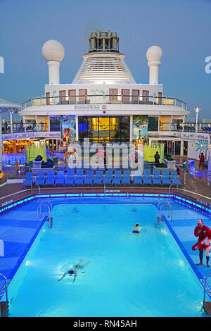 Swimmer in midship pool of Quantum of the Seas mega cruise ship of Royal Cribbean Lines. - Stock Photo