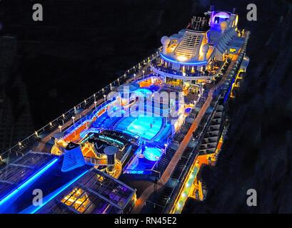 Royal Caribbean mega-cruise ship Quantum of the Seas, at night in East China Sea, from North Sea capsule. - Stock Photo