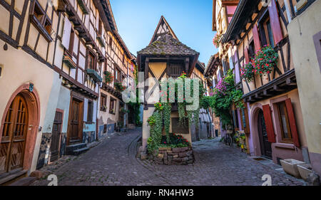 Colorful medieval half timbered buildings in Alsace village in France. - Stock Photo