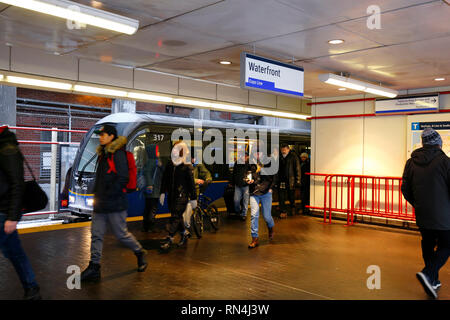 Vancouver Expo Line SkyTrain commuters exiting Waterfront Station - Stock Photo