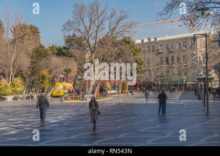 Baku, Azerbaijan,  February 13, 2019. Fountain Square, walking people - Stock Photo