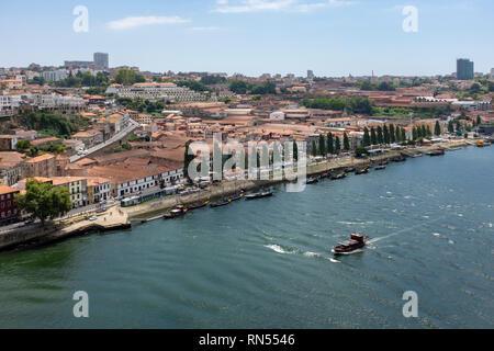 View across the River Douro towards the port houses of Vila Nova de Gaia, Porto, Portugal - Stock Photo