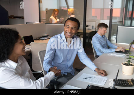 Black business people meet and shaking hands greeting each other  - Stock Photo