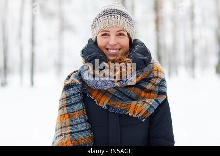 Smiling Young Woman Enjoying Winter