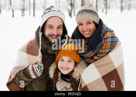 Happy Family Posing in Winter Forest - Stock Photo