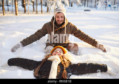 Family Playing in Snow - Stock Photo