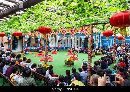 Uygur dancers at Splendid China Folk Village cultural theme park in Shenzhen, China - Stock Photo