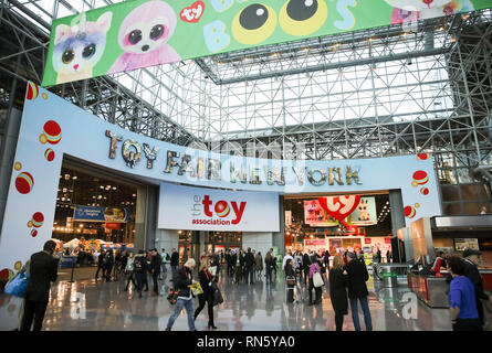 New York, USA. 16th Feb, 2019. Visitors look around at the 116th Annual North American International Toy Fair at the Jacob K. Javits Convention Center in New York, the United States, Feb. 16, 2019. The toy fair, held from February 16 to 19 this year, gathered more than 1,000 toy exhibitors and hundreds of thousands of toys and youth entertainment products to retail outlets and trade guests from over 100 countries and regions. Credit: Wang Ying/Xinhua/Alamy Live News - Stock Photo