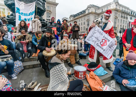 London, UK. 16 February 2019. The 16th 'Reclaim Love' free Valentine's Day street party takes place around the statue of Eros in Piccadilly Circus, with drumming, music, dancing poetry to celebrate love. The event, which was founded by poet Venus CuMara, aims to reclaim love as a manifestation of the human spirit from the sleazy commercialisation which has taken over Valentine's Day as a festival of profit. Credit: Peter Marshall/Alamy Live News - Stock Photo
