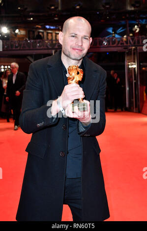 Berlin, Germany. 16th February 2019. Director Nadav Lapid with the Golden Bear for Best Film for 'Synonymes' after the closing ceremony during the 69th Berlin International Film Festival / Berlinale 2019 at Berlinale Palace on February 16, 2019 in Berlin, Germany. Credit: Geisler-Fotopress GmbH/Alamy Live News - Stock Photo