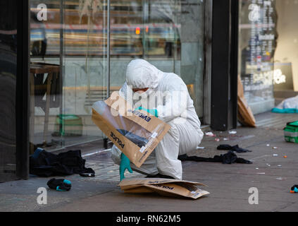 London, UK. 17th Feb 2019. A forensic team take swabs of blood, measurements and remove evidence after 3 men were stabbed. A fight broke out outside Tape nightclub in Mayfair in the early hours of the morning. Two men have been arrested on suspicion of attempted murder. Triple stabbing near Oxford Street, London. Credit: Tommy London/Alamy Live News - Stock Photo