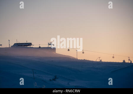 Silhouette of the gondola lift in Levi ski resort in Kittilä, Finland - Stock Photo