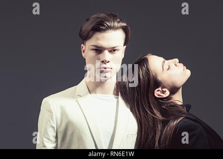 Beauty and fashion. Hair style and skincare. Man and woman. Fashion couple in love. Friendship relations. Family bonds. sadness and misunderstanding - Stock Photo
