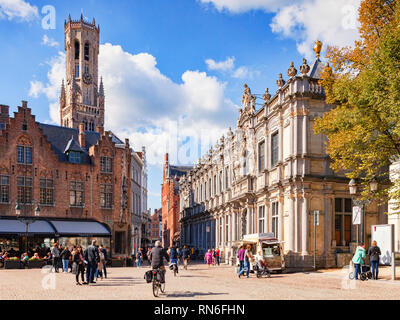 25 September 2018: Bruges, Belgium - View of the Bruges Belfry, or Belfort, from the main square of the city, the Burg. The area is crowded with touri - Stock Photo