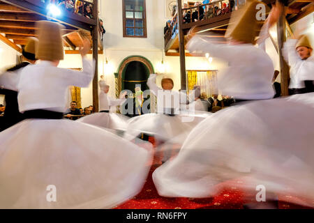 Whirling dervishes in the Culture Centre Of Karabas-i Veli, Bursa, Turkey - Stock Photo